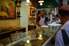 Chef works on a meat sandwich at Da Nerbone in Mercato Centrale Florence.jpg