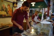Cooks work on orders at Da Nerbone Florence Central Market.jpg