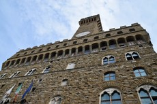 Looking up at Palazzo Vecchio & Its Tower.jpg