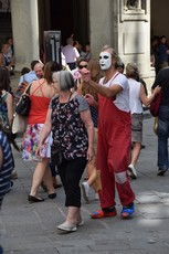 Jester Clown plays a prank on a woman near Piazza dell Signoria.jpg