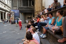 Group of Locals and Tourists sitting at Loggia dei Lanzi watching Clown.jpg
